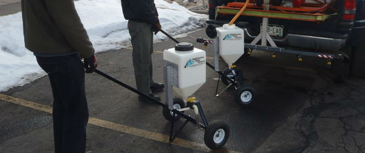 Walk behind sidewalk sprayers for ice control